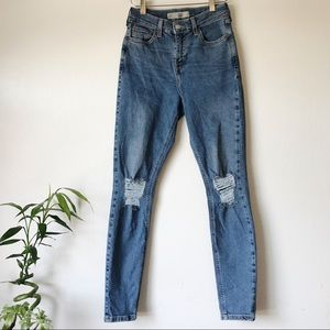Topshop knee high rise ripped jeans.